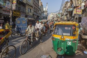 Cargo and people are ferried by rickshaw in Chawri Bazaar, Old Delhi
