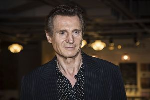 Liam Neeson has come under fire after admitting to walking the streets looking to kill a black person in revenge for the rape of someone he knew. Picture: Vianney Le Caer/Invision/AP