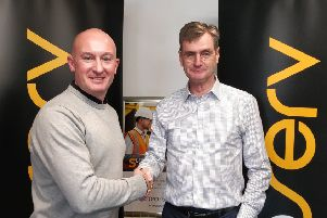 Davis Larssen, CSO at Proserv (left) and James Holt, VP Metering at SGC Metering, shake hands on the deal. Picture: Contributed