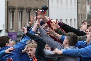 Boys tussle for the leather ball during the annual 'Fastern's E'en Hand Ba' event on Jedburgh's High Street in the Scottish Borders. PRESS ASSOCIATION Photo. Picture date: Thursday February 7, 2019. The annual event, which started in the 1700's, traditionally the first ever game was played with an Englishman's head, involves two teams, the Uppies (residents from the higher part of Jedburgh) and the Doonies (residents from the lower part of Jedburgh) getting the ball to either the top or bottom of the town. The ball, which is made of leather, stuffed with straw and decorated with ribbons representing hair, is thrown into the crowd to begin the game. Photo credit should read: Andrew Milligan/PA Wire