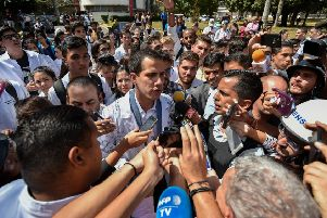 "Venezuela's self-proclaimed ""acting president"" Juan Guaido talks to the media as he takes part in a protest against the government of President Nicolas Maduro (Picture: Luis Robayo/AFP/Getty Images)"