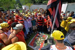 Brazilian football club Flamengo fans gather to lay flowers at the entrance of the club's training center after a deadly fire(Photo by CARL DE SOUZA / AFP)CARL DE SOUZA/AFP/Getty Images