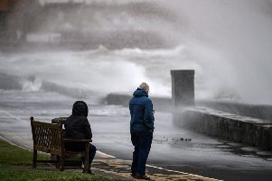 Members of the public look on as Storm Erik makes landfall with winds of up to 70mph. (Photo by Jeff J Mitchell/Getty Images)