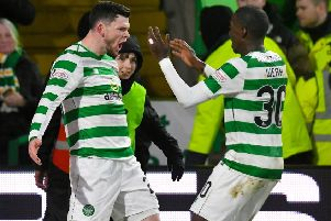 Celtic's Oliver Burke celebrates scoring against Hibs with Timothy Weah. Picture: SNS