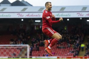 Niall McGinn celebrates after netting the opener. The Northern Irishman also registered two assists. Picture: SNS Group