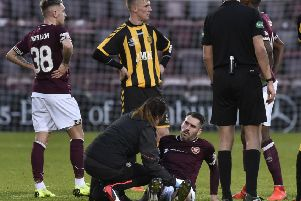 Michael Smith gets  treatment before leaving the field with a torn thigh muscle. Picture: Dave Johnson