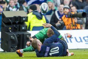 Finn Russell pops up his wonderful offload in the tackle which led to Scotland's only try of the match. Picture: SNS/SRU