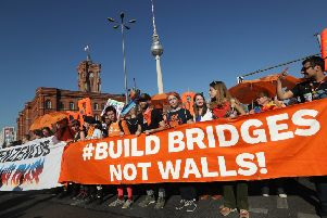 Protesters in Berlin call for an open society and decry increasing divisions in Europe  (Picture: Sean Gallup/Getty Images)