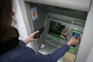 A total of 290 cash machines have been withdrawn from use north of the Border  in addition to 339 bank branches closing. Picture: Matt Cardy/Getty Images