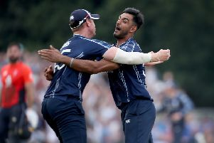 aafyan Sharif, right, celebrates victory over England with Scotland team-mate Alasdair Evans last year. Picture: PA.