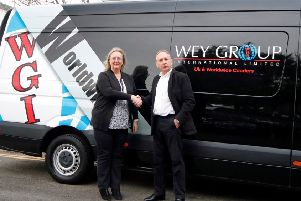Fiona Deas, Eagle Couriers co-director, with Chris Jacobs, director of Wey Group International. Picture: Contributed