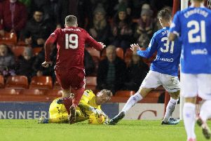 Allan McGregor challenges Lewis Ferguson of Aberdeen during Rangers' recent 4-2 win at Pittodrie. Picture: SNS