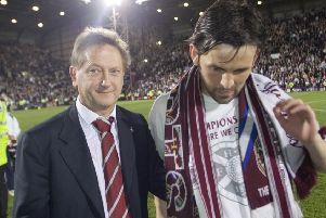 Hearts owner Vladimir Romanov and midfielder Paul Hartley after the club reached the Champions League qualifiers. Picture: SNS