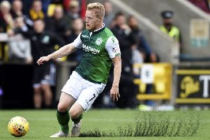 Daryl Horgan in action for Hibs on Livingston's artificial turf. Picture: SNS Group