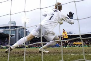 Partick's Conrad Balatoni sees his penalty saved by Queen of the South goalkeeper Lee Robinson in the penalty shootout in the Final at Almondvale