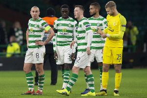 The Celtic players look dejected at full-time. Picture: SNS