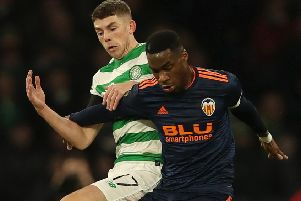 Ryan Christie battles for possession with Valencia's Geoffrey Kondogbia. Pic: Ian MacNicol/Getty