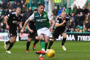 Hibernian's Marc McNulty scores his team's second from the penalty spot. Pic: SNS/Paul Devlin