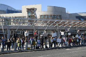 Striking pupils gather outside the Scottish Parliament on Friday. Picture: Greg Macvean