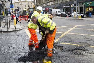Pothole being repaired, Lothian Road Edinburgh.