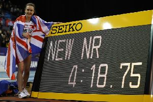 Laura Muir celebrates her new British indoor record after winning the women's mile in Birmingham. Picture: Michael Steele/Getty Images