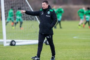 Hibs manager Paul Heckingbottom makes a point as he oversees training. Picture: Ross Parker/SNS