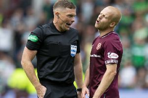 Referee John Beaton about to book Hearts' Steven Naismith. Picture: Ross Parker/SNS