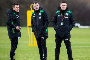 New Hibernian manager Paul Heckingbottom, right, with coach Grant Murray, left, and assistant manager Robbie Stockdale. Picture: Ross Parker/SNS