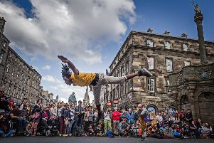 Le Patin Libre from Canada promote their ice show on rollerskates as part of the 2015 Edinburgh Fringe Festival. Picture: Steven Scott Taylor