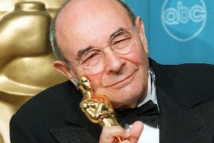 Stanley Donen receives his Life Time Achievement Oscar at the 70th Annual Academy Awards in Los Angeles.  (Picture: AFP/Getty Images)