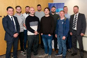 CR Smith managing director Ian Macfarlane (far left) with the firm's apprentices and Frazer Walker, lecturer at Fife College (far right). Picture: Rebecca Lee