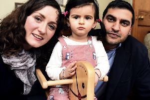 Katherine Behl with daughter Anya, who is 18 months, and father Abhishek. Picture: Lisa Ferguson