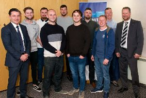 Ian Macfarlane (far left) pictured with CR Smith apprentices, and Frazer Walker, lecturer at Fife College (far right). Picture: Rebecca Lee Photography.