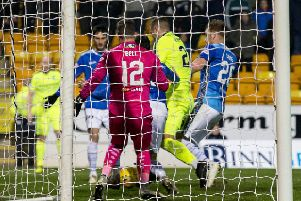 Hibs' Florian Kamberi won a penalty for this challenge by Liam Craig. The striker angered Saints' Murray Davidson by his reaction. Picture: SNS.