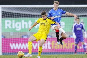 Bartlomiej Gajda (left) takes part in the David Hagen Benefit Game at Falkirk Stadium between a Falkirk/Hearts XI and a Rangers XI. Picture: Michael Gillen