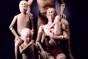 Volvo developed this 'family' of crash-test dummies but other manufacturers designed vehicles based on a model of a man (Picture: PA)