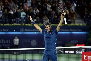 Roger Federer celebrates after winning the final match at the ATP Dubai Tennis Championship. Pic: Karim Sahib/AFPGetty Images