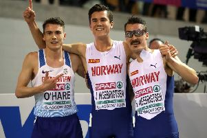 Chris O'Hare, left, celebrates with Norway's Jakob, centre, and Henrik Ingebrigtsen after the 3000m final. Photograph: Jane Barlow/PA Wire
