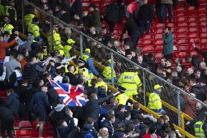A seat is thrown as Aberdeen and Rangers fans clash at Pittodrie. Picture: SNS Group