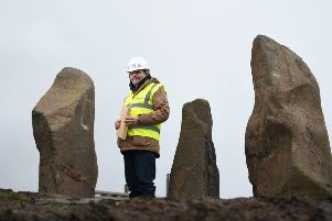 Science writer Duncan Lunan inspects the new site of his modern-day stone circle, which has been moved in its entirety as part of a �250m regeneration of Glasgow's Sighthill area. Picture: John Devlin