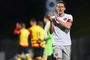 Hearts skipper Christophe Berra applauds the travelling fans after the 1-1 draw with Partick Thistle in the Scottish Cup quarter-final. Picture: SNS