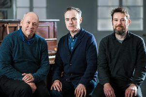 John Crowley, centre, with Mark Knopfler, left, and David Greig