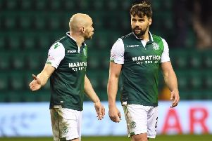 Seconds after the full-time whistle David Gray and Darren McGregor have already opened the inquest into Hibs' defeat by Celtic. Picture: SNS.