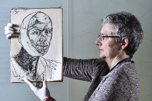 Curator Dorothy Kidd holds a sketch by Edwin Lucas, from 1943 or 1944. Picture: Neil Hanna