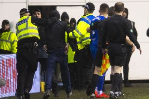 A Hibs fan was led away by police after confronting James Tavernier. Picture: SNS
