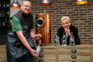 NB Distillery head of production Steve Ross and sales chief Rhona Hartley with the dispenser that will be used to refill customers' bottles. Photograph: Scott Louden