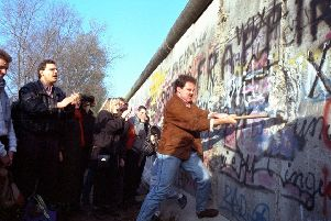 The Berlin Wall fell as the internet was starting to open up the world (Picture: John Gaps III/AP)
