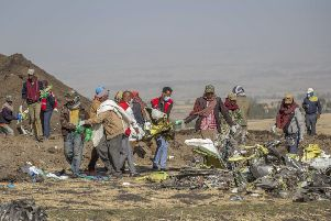 Rescuers work at the scene of an Ethiopian Airlines flight crash south of Addis Ababa,  Ethiopia (Picture: Mulugeta Ayene/AP)