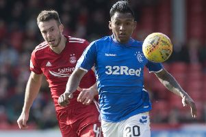 Alfredo Morelos will come up against Andrew Considine at Ibrox this evening. Picture: SNS Group