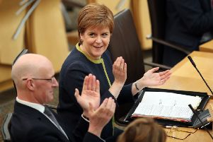 Nicola Sturgeon is facing MSPs at First Minister's Questions
